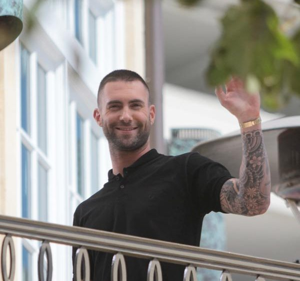 Adam Levine got a buzz cut, and a million women cried. He's still hot.