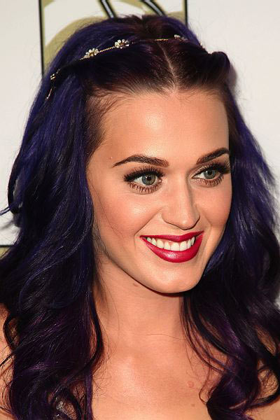 Katy Perry dyes her hair pruple for Coachella.