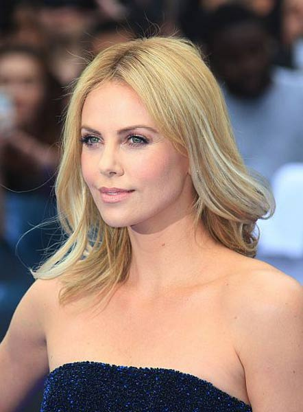 12 06 hair news charlize theron shaved head
