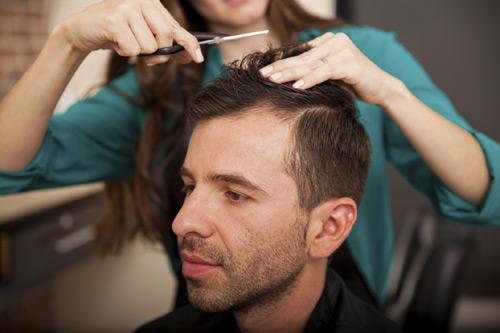 woman cutting mans hair